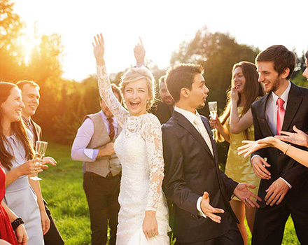 Couple celebrating wedding with friends