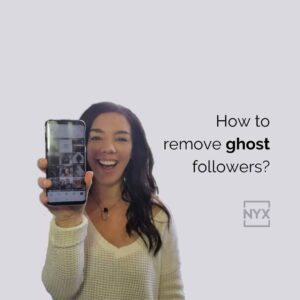 woman holding phone showing ghost followers
